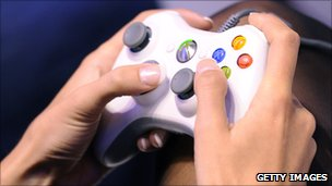 An Xbox controller in a gamer's hands