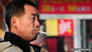 A man lights up in Beijing.