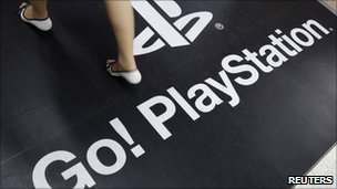Woman walking on PlayStation logo, Reuters