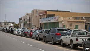 Motorists wait in a queue to buy fuel, in Tripoli, Libya, 21 April, 2011