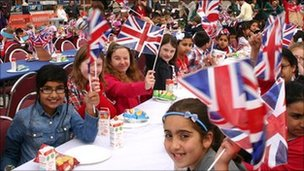 Children celebrate in Gravesend a day before the royal wedding