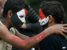 Two Egyptian protestors with painted faces