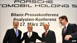 Porsche Automobile Holding chief Martin Winterkorn and Porsche chief Matthias Mueller, flanked by board members Hans Dieter Poetsch (L) and Thomas Edig (R)