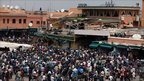 Crowds in Djemaa el-Fna square in Marrakesh after a blast tore through a cafe there, killing at least 14 people, on Thursday