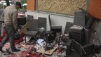 A man walks through debris after an explosion ripped through Argana cafe in the Moroccan city of Marrakesh on Thursday