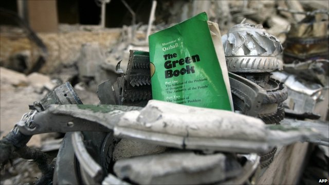 A copy of Col Gadaffi&#039;s Green Book amid rubble in Tripoli on 10/4/11 