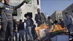 Libyans burn copies of the Green Book in Benghazi on 2/4/11