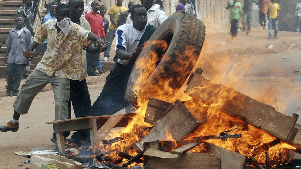 Rioters burn tyres and wood in the capital city Kampala, Uganda, Friday 29 April 2011