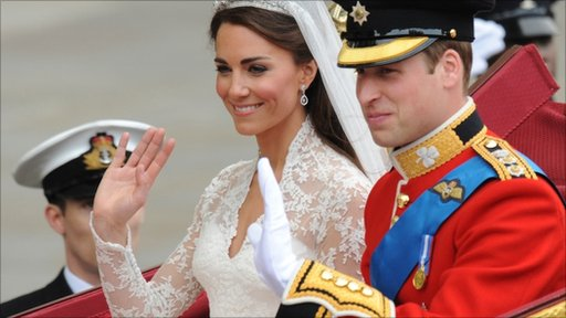 Prince William and his wife, the newly-titled Duchess of Cambridge, in the carriage after their wedding ceremony