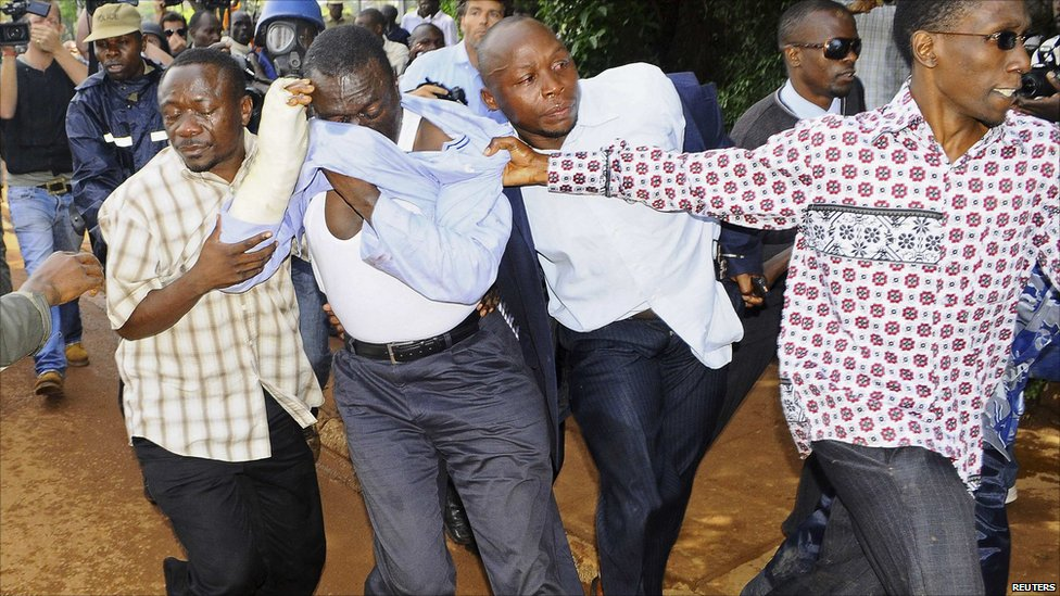 Uganda's Forum for Democratic Change leader Kizza Besigye (2nd L) is arrested by plainclothes policemen in the capital Kampala, 28 April 2011