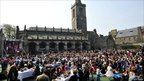 Crowds in St Salvator's Quad gather to watch the royal wedding