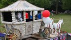 A model of a horse and carriage riding through Bucklebury in Berkshire