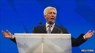 Gilles Duceppe speaking at a podium