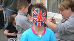Boy with his face painted with a Union Jack