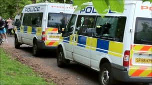 police vans with windows smashed