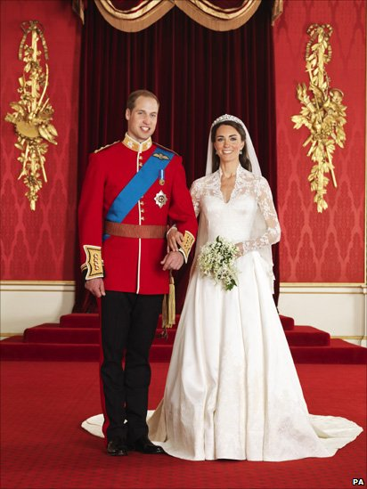 The Duke and Duchess of Cambridge in the throne room at Buckingham Palace after their wedding.