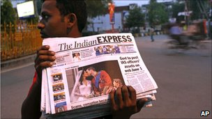 A vendor brings news of the wedding to the people of Allahabad, India