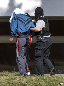 One of the suspected al-Qaeda members is brought to court in Karlsruhe, 30 April