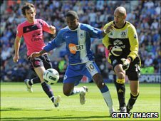 Goalscorers Leighton Baines and Charles Nzogbia with Tim Howard