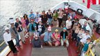 Group of people on a ship. Photo: W. Crawford, USIO-TAMU