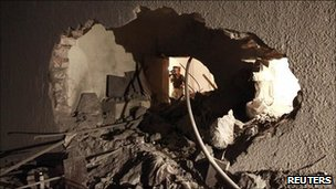 Damage at the house of Saif Al-Arab Gaddafi that Libya's government said was made by a Nato air strike