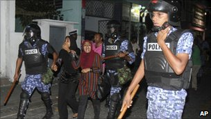 Maldivian police detain female protesters in Male, Maldives, on 1 May 2011