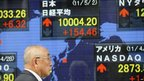 A man looks at the closing figures of the Tokyo Stock Exchange on 2 May 2011