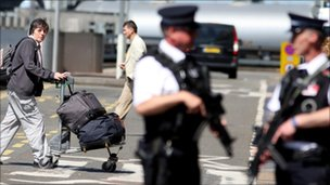Police officers carry out routine searches of Heathrow's Terminal 1 as one of Osama bin Laden's high-profile supporters in the UK warned of another 7/7-style terror attack in the wake of his death