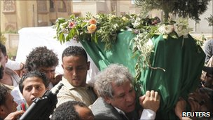 Libyans attend the funeral of Saif al-Arab Gaddafi in Tripoli