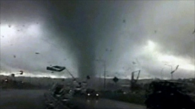 Tornado moving across a road