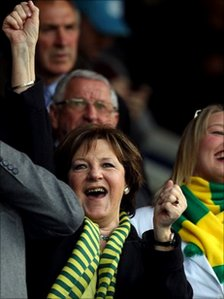 Delia Smith leads the Norwich City fans in celebration as they are promoted to the Premier League