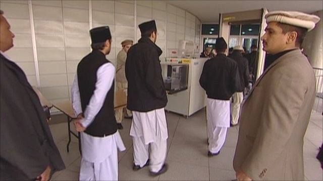 Muslims at a London mosque go through a security scanner