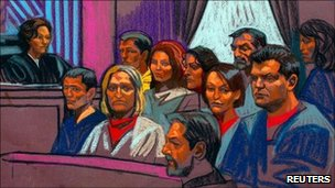 Russian spy suspects in a Manhattan courtroom sketch, 8 July 2010. Back row, from L to R: Mikhail Semenko, Anna Chapman, Vicky Pelaez, Juan Lazaro and Patricia Mills. Front row, from L to R: Michael Zottoliare, Tracey Lee Ann Foley, Donald Howard Heathfield, Cynthia Murphy and Richard Murphy.