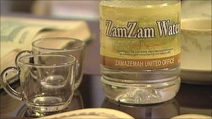 "A bottle of ""Zam Zam"" water"
