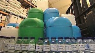 Bottles of Zam Zam water in a warehouse in London