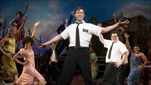 Andrew Rannells (centre) performs in The Book of Mormon