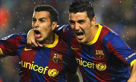 Pedro and David Villa celebrate Barca opening the scoring
