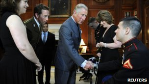 Prince Charles greets amputee during US visit
