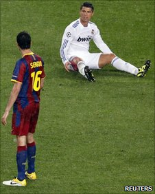 Sergio Busquets and Cristiano Ronaldo