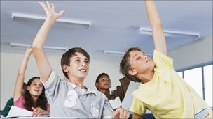 Boys raising hands [Thinkstock]