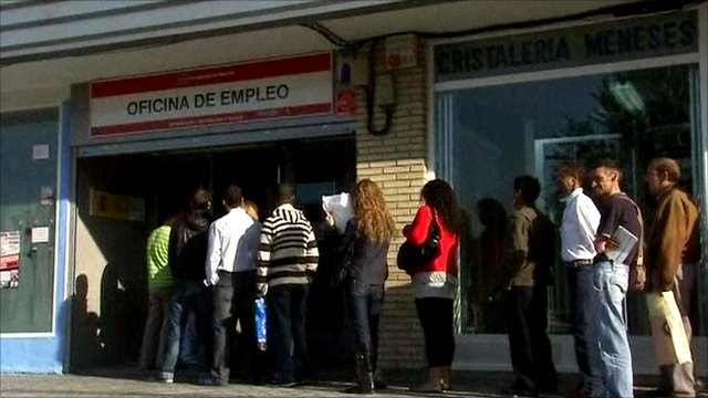 Spanish people queue outside employment office