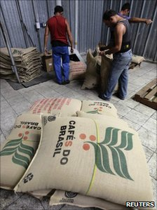 Workers handles sacks of coffee imported from Brazil