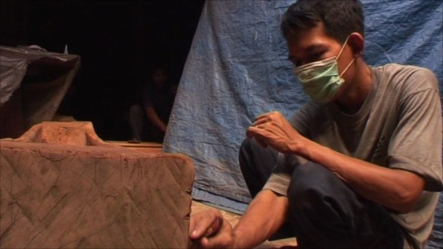 Man working with wood