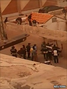 Men appear to break into a compound in Deraa on 1 May in this still image taken from amateur video (Unverified)
