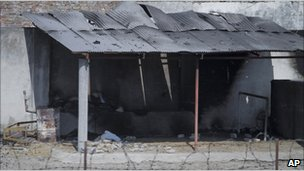 Part of the compound - half burnt out - after the raid