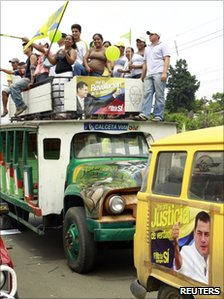 Ecuadorean demonstrators in favour of an upcoming referendum stand on the top of a bus during a political rally in Tosagua May 3, 2011