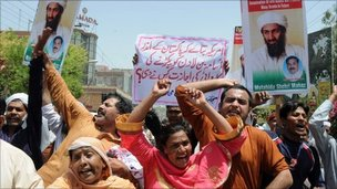 People chant anti-American slogans during a rally to condemn the killing of al-Qaida leader Osama bin Laden, in Multan, Pakistan on Wednesday, May 4, 2011.