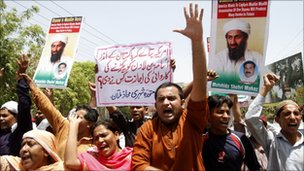 Demonstrators hold posters of al Qaeda leader Osama bin Laden, who was killed on Monday in a U.S. special forces assault on a Pakistani compound, as they chant anti-U.S. slogans during a rally of more than 100 people in Multan May 4, 2011.