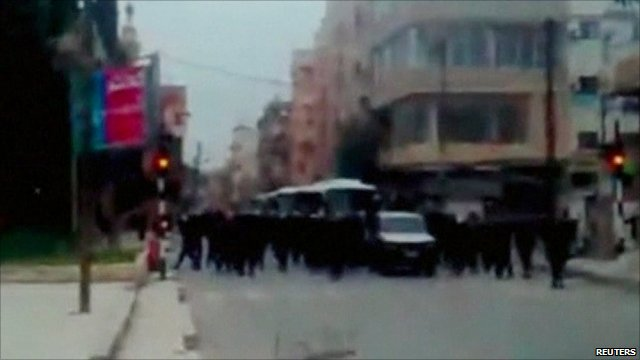 Security forces advance along a road in Deraa in a still image taken from an amateur video, 1 May 2011 (unverified)