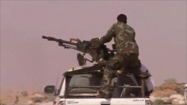 An armed rebel fighting in Libya